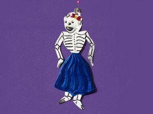 Skeleton Woman, tin figure