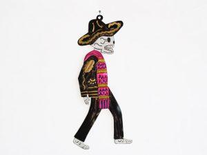 Skeleton Charro wearing pink serape, tin wall decor, black, 9.5-inch