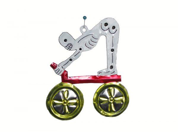 Skeleton Riding Wagon, flat tin figure