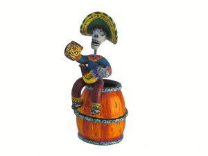 Skeleton Sitting on Beer Barrel, polychrome pottery sculpture